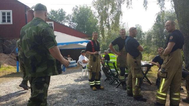 fire fighters having a short break